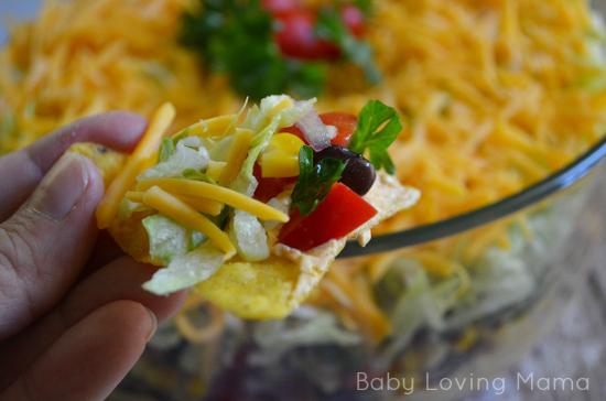Fiesta Layer Dip on a tortilla chip