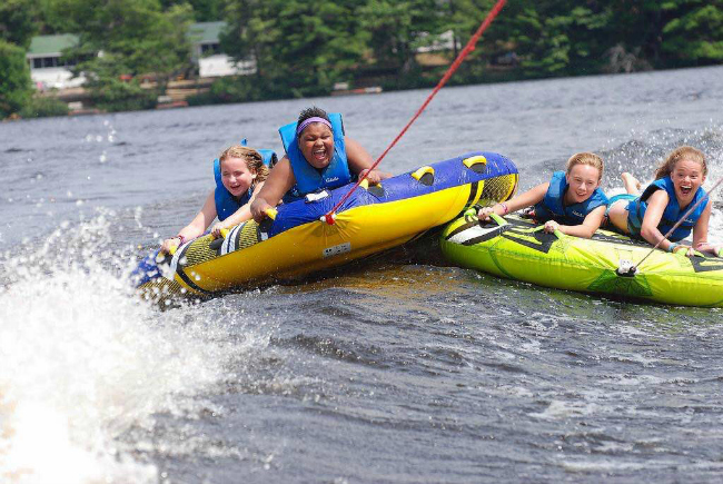 Darci Sullivan (far right) enjoys a wet and wild ride at Angel Adventures