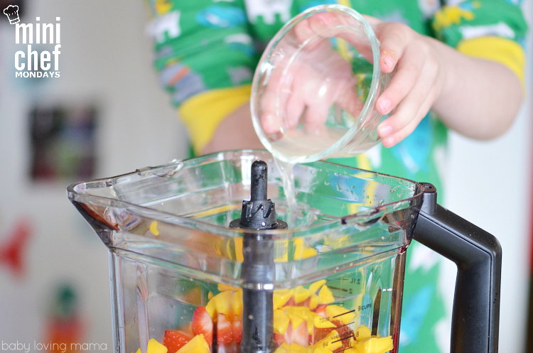 Child Adding Lime Juice to Blender for Italian Ice